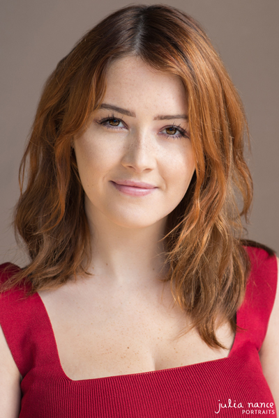Melbourne natural light actor headshot of redhead woman in a red top.