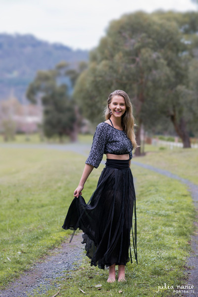 Melbourne Acting headshot of woman outdoors with bare feet and long skirt