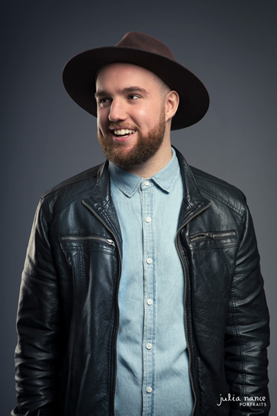 Studio portrait of a musician in a cowboy hat