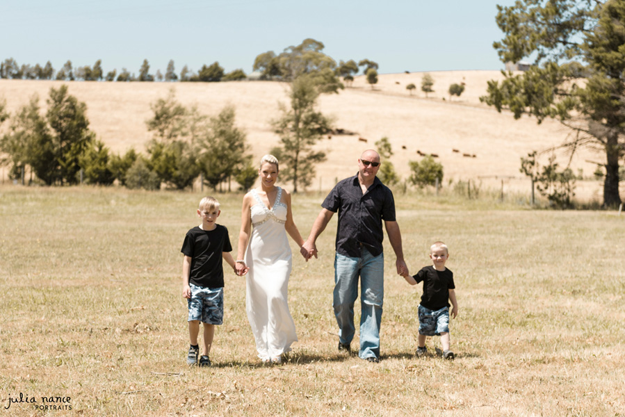 Family Photography Melbourne and Yarra Valley - Family walking through field holding hands