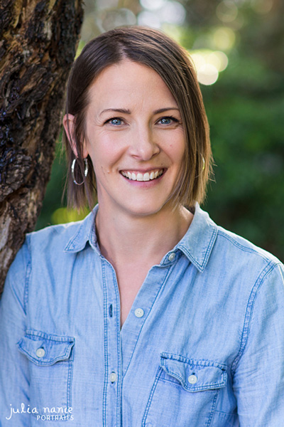 Woman smiling outdoors next to tree - Melbourne headshots - Headshot photography - linkedin headshots