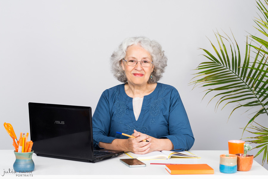 Woman sitting at desk with laptop and stationary - Melbourne corporate and personal branding photography