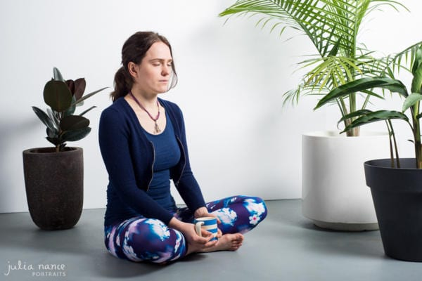 melbourne corporate headshot photography of Tracy meditating with indoor plants