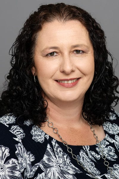 Melbourne staff headshot with grey studio background