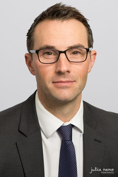 Melbourne staff headshot of employee on light grey background
