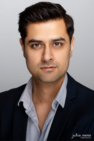 Melbourne actor headshot of a man with serious expression on pale grey background